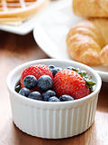 breakfast setting with blueberries and strawberries.