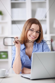 Girl with glasses at home