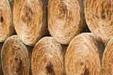 Stack of round hay bales drying outdoors