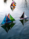 Colourful model pond yachts
