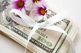 dollars with flowers and bow