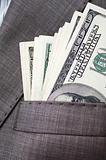 dollars in the pocket of business suit