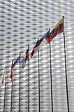 various flags on modern architecture background