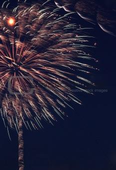 Firework streaks in night sky, celebration background