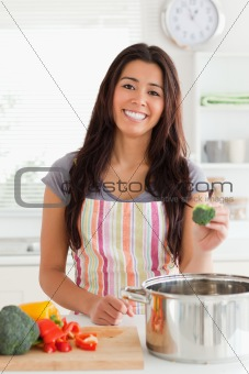 Attractive woman preparing vegetables while standing