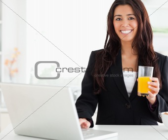 Beautiful woman in suit relaxing with her laptop
