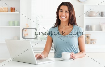 Good looking woman enjoying a cup of coffee while relaxing