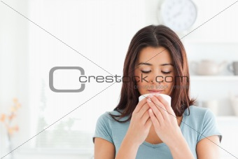 Charming woman enjoying a cup of coffee