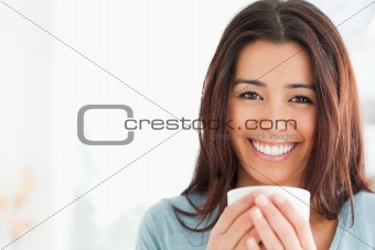 Portrait of an attractive woman enjoying a cup of coffee