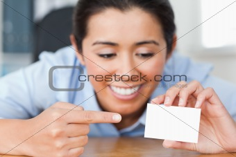 Beautiful woman showing her visiting card