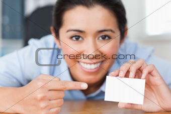 Attractive woman showing her visiting card