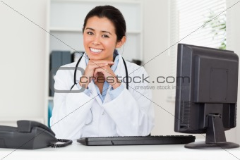 Attractive woman doctor posing while sitting