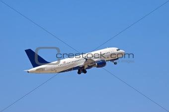 A jet plane flying into a blue sky.