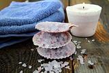Spa still life .Bath lilac salt, towel and  candle