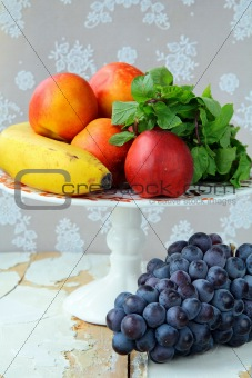 assortment of summer fruits - peaches, apples, grapes, bananas