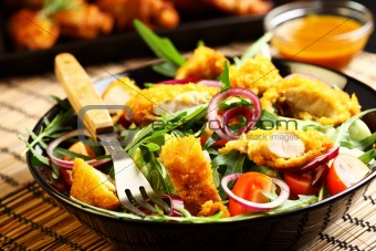Gourmet salad with curry chicken stripes