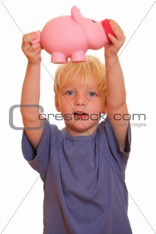 Boy shows a piggy bank