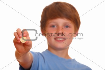 Boy showing a coin