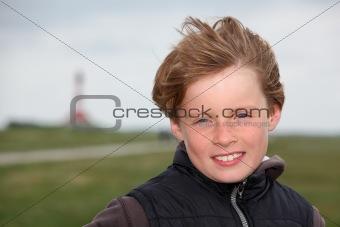 Boy in the autumn wind