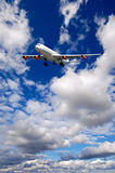 Air travel - Plane is flying in blue sky with clouds