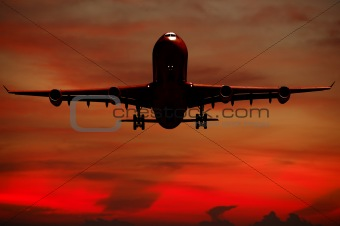 Air travel - Silhouett of plane and sunset