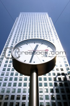 A skyscraper and street clocks