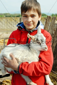 Teenage boy with little goat