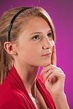 Teenage Female Girl Thinking Isolated on Pink