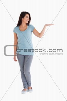 Beautiful woman showing a copy space while standing