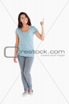 Beautiful woman showing a copy space with her finger