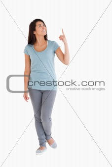 Attractive woman showing a copy space with her finger