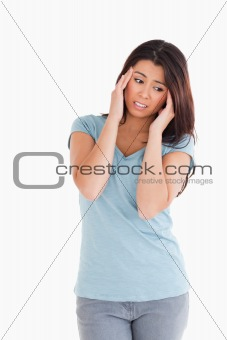 Attractive woman having a headache while standing