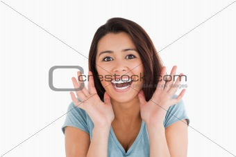 Portrait of an excited woman standing