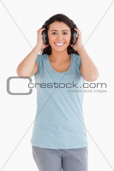 Attractive woman using her headphones while posing