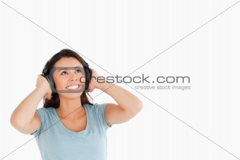 Attractive woman with headphones looking at something