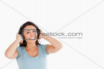 Attractive woman with headphones posing