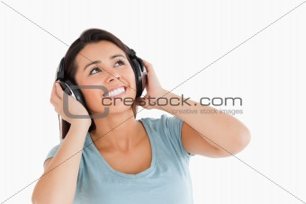 Beautiful woman with headphones looking at something