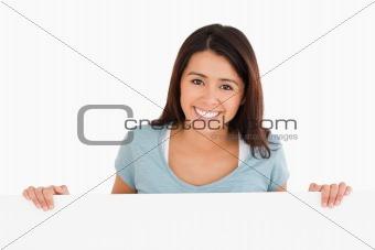 Beautiful woman holding a  board