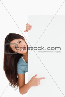 Lovely woman pointing at a board