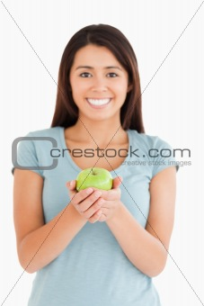 Attractive woman holding a green apple