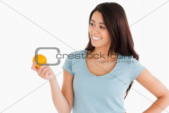 Attractive woman holding an orange