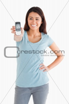 Attractive woman showing her mobile phone