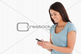 Attractive woman writing a text on her mobile phone