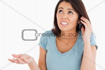 Beautiful upset woman on the phone