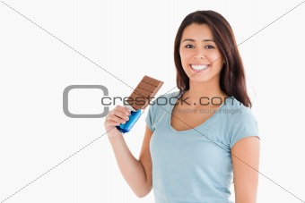 Lovely female holding a chocolate bar