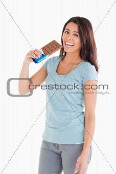 Beautiful woman eating a chocolate bar
