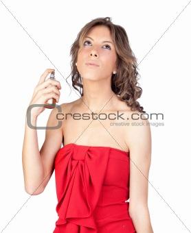 Beautiful girl perfuming