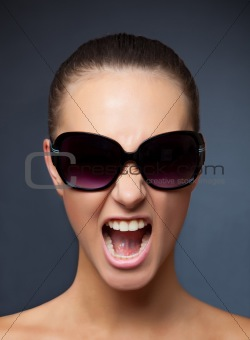 Screaming girl with sunglasses