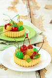 dessert tartlet with colored cocktail cherries