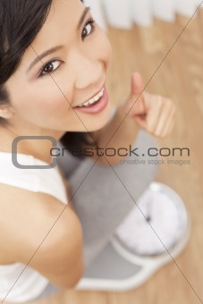 Asian Chinese Woman Thumbs Up Weighing Herself on Scales